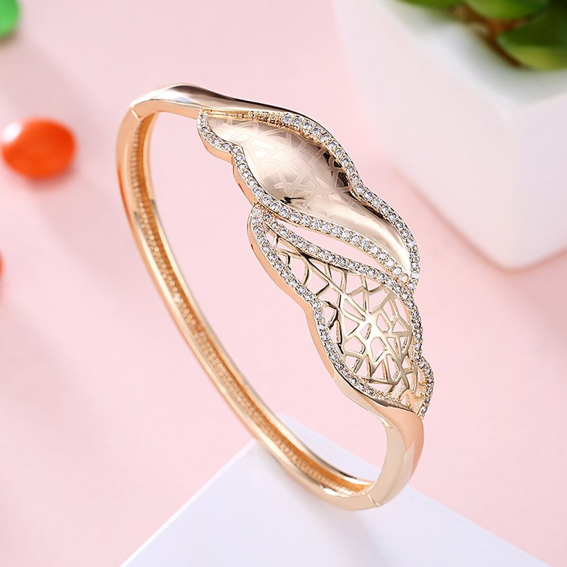 Wholesale Leaves to hollow out Champagne Gold CZ Bangle TGGPBL052 1